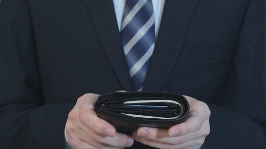 Thumbnail for Businessman Gets Money From Her Wallet and Counted