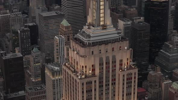 Thumbnail for AERIAL: Close Up of Empire State Building at Dusk with Lights on