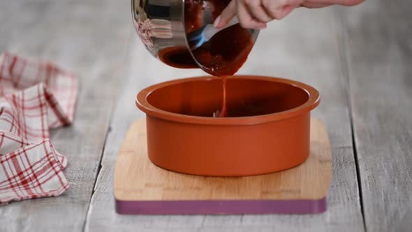 Pouring Cherry Jelly Into Silicone Mold.