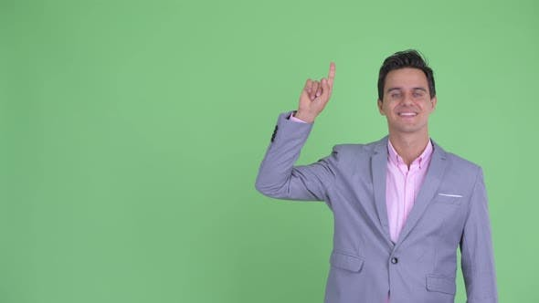 Thumbnail for Happy Young Handsome Businessman Pointing Up