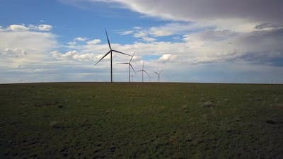 Aerial of windmills in a row in the field