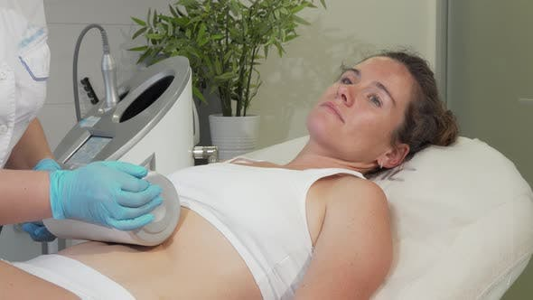 Thumbnail for Mature Woman Enjoying Endospheres Hardware Massage at Beauty Clinic