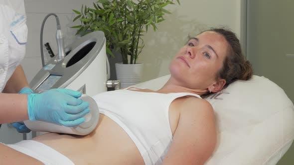 Thumbnail for Mature Woman Enjoying Endospheres Hardware Massage at Beauty Clinic