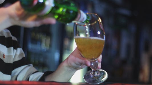 Thumbnail for Bartender Pours Beer