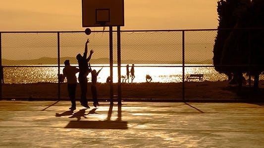 Thumbnail for Playing Basketball at Sunset