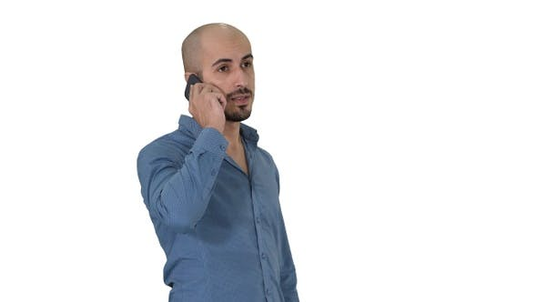 Cover Image for Serious arab talking on the phone on white background.