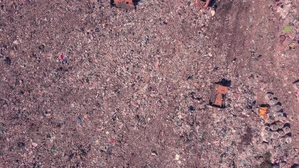 Garbage Dump Top View Working People and Bulldozers. Ukraine, the Environmental Problem of Unsorted