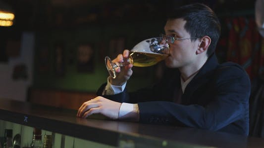 Thumbnail for Businessman Drinking Beer in the Pub