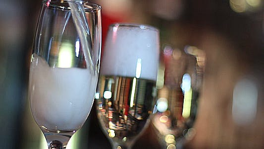 Thumbnail for Pouring Champagne Glasses in the Bar
