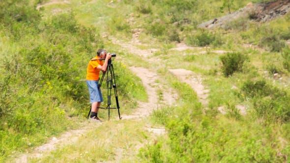Thumbnail for Man Shoots Landscapes