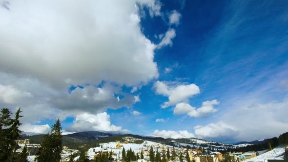 Thumbnail for Clouds Moving Over The Top Of The Mountain