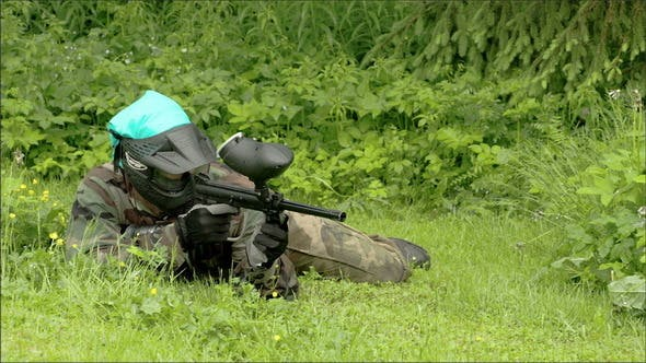 A Man Eyeing for an Enemy with a Paintball