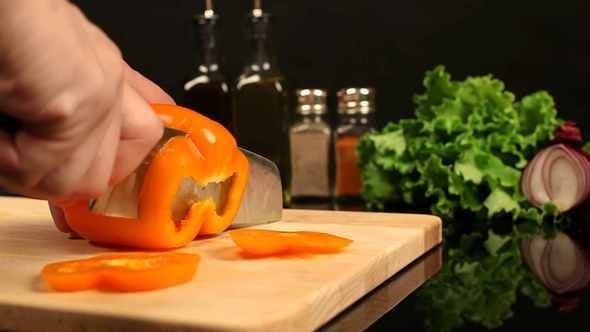 Thumbnail for Man Chopped Orange Bell Pepper