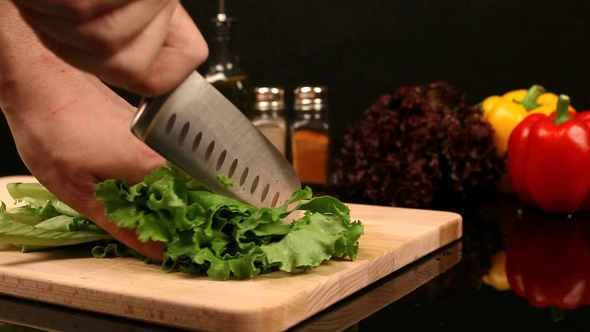 Thumbnail for Man Chopped Lettuce Is On A Cutting Board