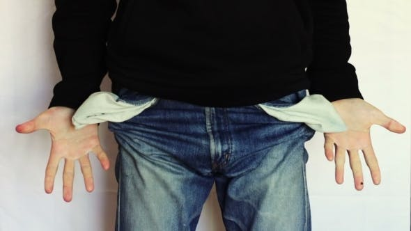 Thumbnail for Man Turns The Empty Pockets Of His Jeans. No Money