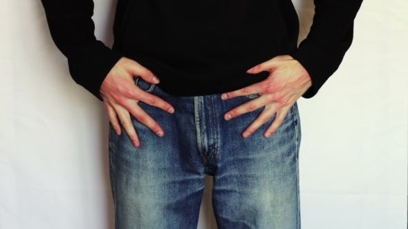 Thumbnail for Man Turns The Empty Pockets Of His Jeans, No Money