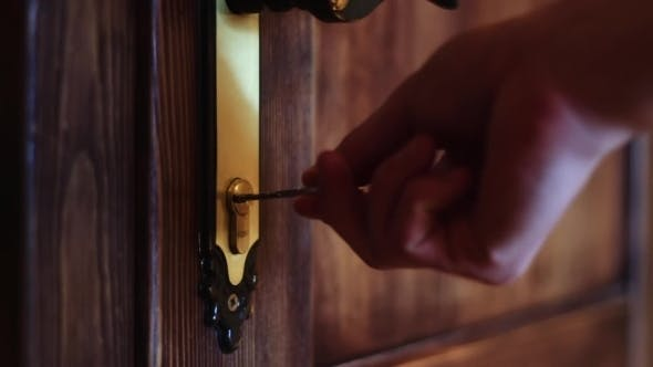 Thumbnail for The Man Opens The Door Using The Key