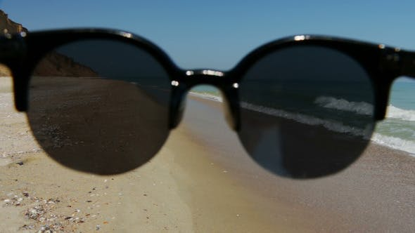 Thumbnail for Empty Beach and Sunglasses
