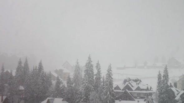 Thumbnail for Heavy Snowfall On The Background Of Houses