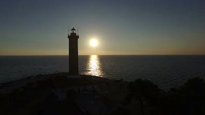 Tracking shot of lighthouse, Croatia at sunset