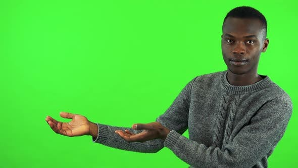 Thumbnail for A Young Black Man Presents Something - Green Screen Studio