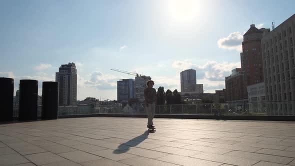 Thumbnail for Active Man Skating on Longboard Outdoors