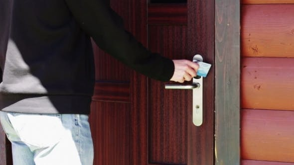 Thumbnail for The Man Opens The Door To An Electronic Key - Card