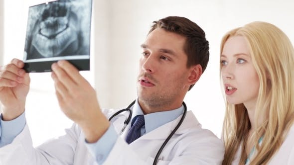 Thumbnail for Two Doctors Discussing X-ray Image At Hospital