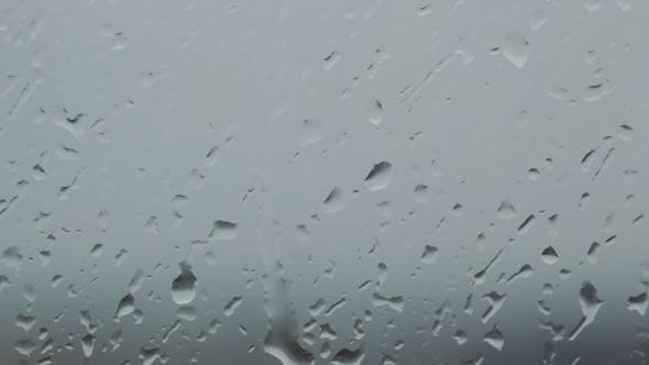 Grey Rainy Glass With Water Drops