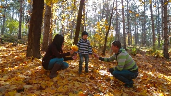 Thumbnail for Young Family With A Little Boy Picking Up Yellow