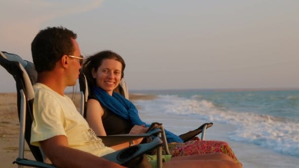 Thumbnail for Portrait Of Romantic Couple Relaxing On Folding