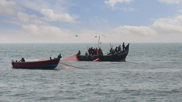 Thumbnail for Fishermen In Boats Pulling Fishing Nets