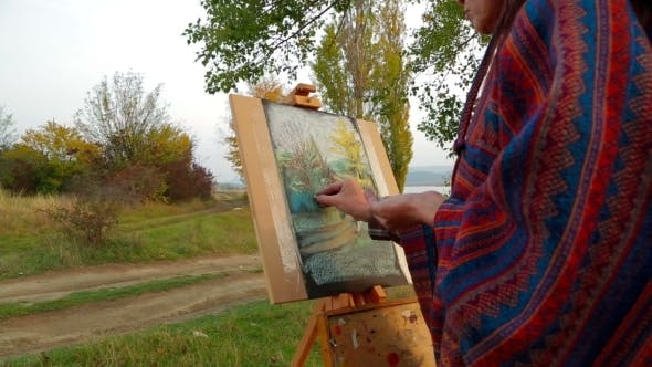 Thumbnail for Brown Haired Woman  Drawing A Picture At Plein Air