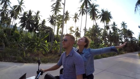 Thumbnail for Couple Riding Motorcycle Against Sunset