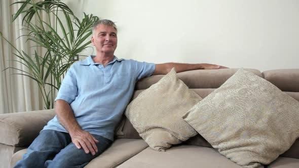 Thumbnail for Senior man relaxing on sofa
