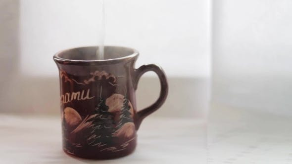 Thumbnail for Pouring Hot Water Into The Mug, White Background