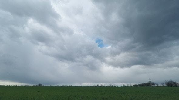 Thumbnail for Dark Clouds Sweep Over the Green Field
