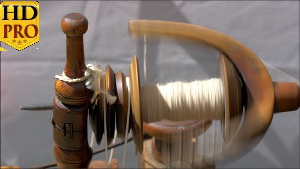 An Old Spinning Wheel Fastly Turning Around