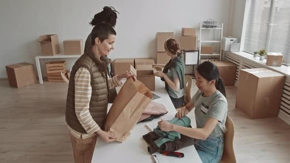 Volunteer Organization Members Sorting Donated Items