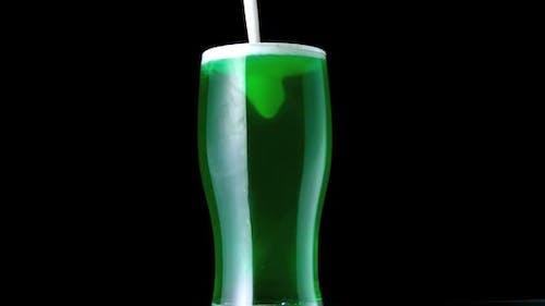 Foam Falling Into Pint Of Green Beer