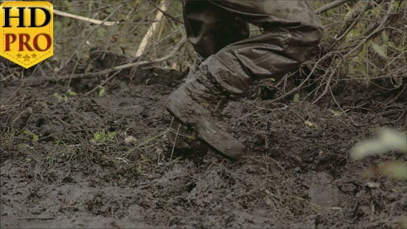 Thumbnail for A Man in Boots Walking onto the Thick Mud