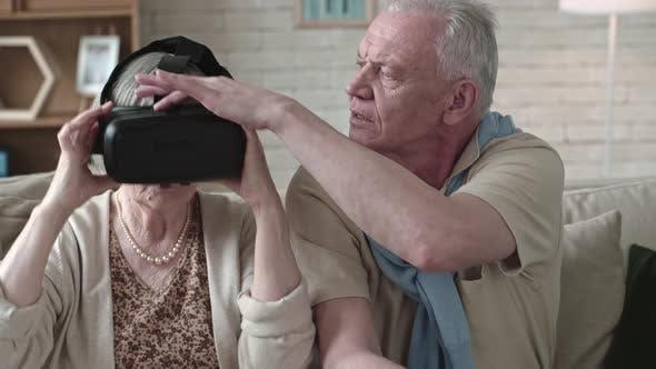 Elderly Couple Trying VR Glasses