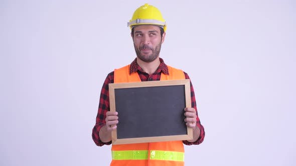 Cover Image for Happy Bearded Persian Man Construction Worker Thinking While Holding Blackboard