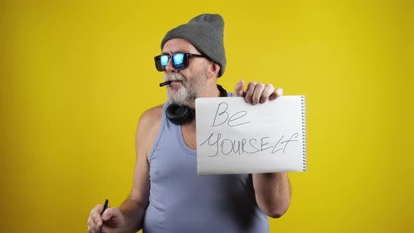 Thumbnail for Cool mature man write phrase Be Yourself