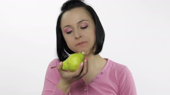 Thumbnail for Young Beautiful Woman Eating Big, and Juicy Green Pear on White Background