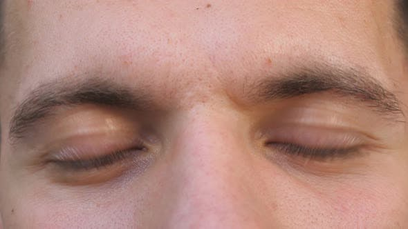 Thumbnail for Detail View Brown Eyes of Guy Staring and Blinking with a Tired Sight. Portrait of Male Face Looking