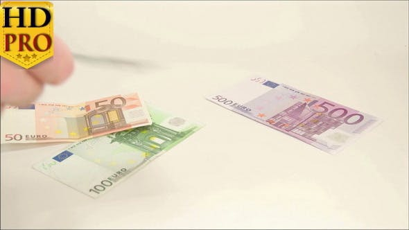 Five Euro Bills Thrown on the Table