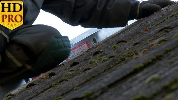 Thumbnail for Closer Look of the Roofer Getting Off the Nails