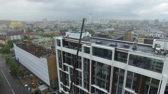 Crane Lifting Glass Panels on Building Upper Floor, Aerial