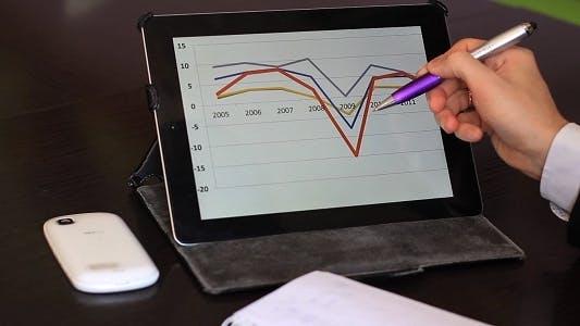 Thumbnail for Man Looking At A Graph Tablet